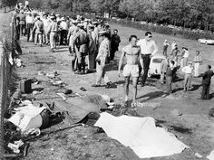 Dead bodies lie on the ground as policemen try to evacuate people from the scene of the accident caused by German driver Wolfgang von Trips, whose Ferrari crashed into the crowd killing 15 spectators during the Italian Formula One Grand Prix, on September 10, 1961 in Monza. Wolfgang von Trips, who was thrown out of his car, also died in one of the most tragic accidents in Formula One history. AFP PHOTO