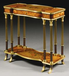 A LOUIS XVI STYLE GILT-BRONZE MOUNTED KINGWOOD, BURRWOOD, SYCOMORE AND STAINED FRUITWOOD MARQUETRY TABLE, FRANCE, LATE 19TH/EARLY 20TH CENTURY, ATTRIBUTED TO MAISON KRIEGER FL. 1826-1900 | Sotheby's