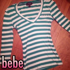 BEBE  long sleeve striped logo tshirt small NWOT Perfect new condition. Bebe. Green and white striped. Rhinestone logo. Small bebe Tops Tees - Long Sleeve