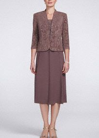 Classic and demure, this is perfect Mother of the Bride dress no matter what the season! Sleevless bodice features a stunning Jacquard knit design. Flowy sheer matte jersey skirt is comfortable and hits at mid-calf. 3/4 sleeve jacket with front button closure adds just the right amount of coverage. Fully lined. Back zip. Imported acetate/spandex/poly blend.A luxuriously soft fabric with a bit of stretch. A new favorite because of its versatility: beautiful drape, wrinkle resistant and…