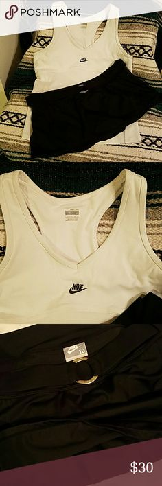 NWOT 2 Piece Nike Sports Bra Tank & Skirt NWOT NEVER WORN!!  Set includes BOTH PIECES!!!!  Super cute Nike white Sports Bra Tank  - Size Large  ***** And bundle also includes: Nike Swim/Workout/Golf skirt with built in panty  - Size 10,  also has cute attached belt with silver ring. - Back of skirt has Nike Swoosh on it.  Super cute! Nike Swim