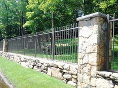Image result for rock and wrought iron fencing for small dogs