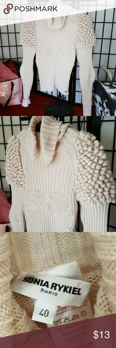 Paris designer sweater unique design soft stretch This is a Paris designer sweater in a very unique design very complimentary to the womanly body size European 40 a very very pale pink almost cream color this is a showstopper for sure they're unique no one's going to have one like it minor signs of wear or damage see photo . Small strteched hole in fold of cowl neck . Easy fix . Reflected in price .  mock turtleneck more like a cowl neck smoke-free closet  shoulders 16 inches across 23…
