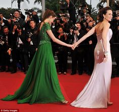 Love the green Elie Saab dress -  Andie MacDowell helps her daughter navigate the sea of cameras at the closing ceremony of the 65th Cannes Film Festival