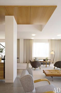 FLUSH BASEBOARD DETAIL. Modern Living Room by Shelton, Mindel & Associates and Shelton, Mindel & Associates in New York, New York.