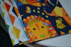 African Adventures Reversible Cloth Napkins/Set of 4. Bring a piece of Africa to your home. These napkins are made from fabrics by designer Michael Miller. This set of four reversible napkins is made from prewashed 100% cotton material. You can choose which side you want depending on your mood; in effect, it is like getting two sets of napkins in one. Please note that our napkins are smaller than the average cloth napkin. They measure 7¼ inches by 7¼ inches, which we have found to be a…