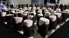 Marshmallows dipped in dark chocolate and then dipped in crushed Oreos....heaven!