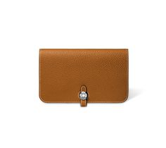 """Dogon  Combined wallet in gold, togo calfskin, 8"""" x 5"""" with signature palladium 'Clou de selle' tab closure, 5 credit card slots, 6 1/2"""" x 4"""" removable change purse with additional 2 credit card slots"""