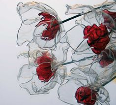 Cut outer petals from clear water bottles, melt edges then glue together. Cut smaller petals for inside, use glass paint for color, glue in place with black beads in center. Wire one bead for stem and pass it through the middle.