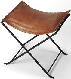 Melton Brown Leather Stool - Leather meets iron for a simple seat, ideal for any spot in your home. Great alone or in multiples, its carefully stitched warm brown leather seat is supported by an understated black iron base that folds eaily Leather Footstool, Leather Stool, Real Leather, Brown Leather, Vanity Stool, Leather Conditioner, Butterfly Chair, Industrial Chic, Medium Brown