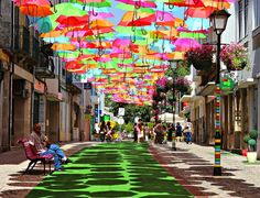 Colorful Umbrellas Magically Float in Mid-Air - Art installation in Agueda, Portugal