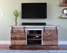 Barn door media console plans barn door entertainment center for console kitchen fascinating sliding media plans . Barn Door Tv Stand, Barn Door Console, Diy Sliding Door, Sliding Table, Johnny Walker, Rack Pallet, Built In Entertainment Center, Saloon, Diy Tv Stand