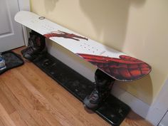 snowboard bench made by my dad...he screwed two pieces of wood to the board, then put the wood into the boots with cement and then added the wood under the boots to make it extra sturdy