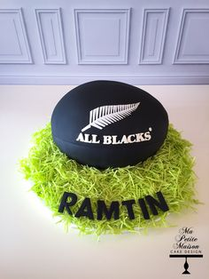 New Zealand NZ All Blacks black rugby ball birthday cake for Ramtin equipped with edible grass