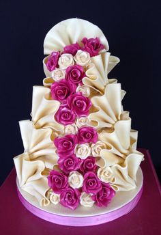 A Yummy White Chocolate Fan Wedding Cake Dressed With Cream And Fuchsia Pink Roses