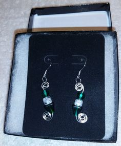 Handmade Hand Formed silver plated wire earrings made with Emerald Green and White Czech beads and Fish hooks by FireryangelCreations on Etsy