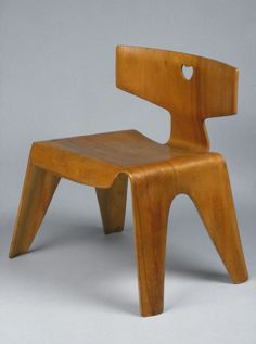 Childs Chair. This molded plywood chair is part of a suite of furniture the Eameses designed in 1946 specifically for children. This project reflects an increasing interest in the postwar period in creating modern furniture, toys, and other objects for the use and benefit of young children. While recalling their other popular plywood chairs of this period, the LCW (Lounge Chair Wood) and DCW (Dining Chair Wood), this chair is simpler in design and construction