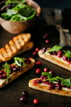 Make even easier by using dried cranberries soaked in o.j.  OR Grand Marnier instead of cooking fresh berries - Cranberry Brie & Arugula Crostini