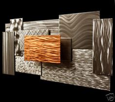 Abstract steel, copper and modern metals wall sculpture.