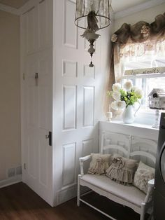 Junk Chic Cottage -- doors to hide water heater