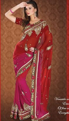 A modern twist to classic can be seen in this rich red and pink color combination saree is crafted on faux georgette fabric. Designed with contrast patchwork border adorned with stones, beads, sequins, resham and zari embroidery. Paired with matching blouse with embroidery and you are officially ready to dazzle.