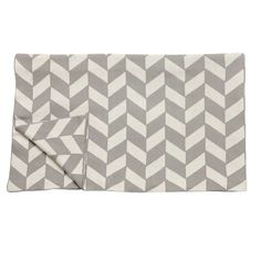 We love this cool contemporary throw from danish homeware brand Hubsch. Made from a supersoft cotton and in a stunning geometric pattern, it makes great stateme