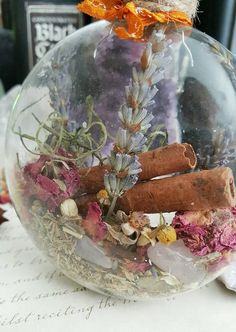 Lavender to encourage a calm, peaceful environment, chamomile to aid in relieving anxiety, yarrow/ roses/rose quartz crystals to encourage self-love and love in relationships, jasmine to attract wealth and sweet dreams, cinnamon to draw happiness and comfort, a sea shell and a shark tooth to incorporate the magic of the sea, cloves to attract good luck and prosperity, anise wards off the evil eye, bay leaf for protection