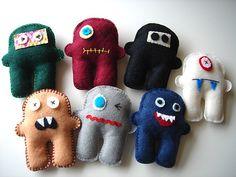 I like the cute-monster themed toys - especially these handmade plush guys. Felt monster friends by craftsholic on Etsy. Softies, Monster Toys, Sock Monster, Mini Monster, Felt Finger Puppets, Diy Cat Toys, Softie Pattern, Ugly Dolls, Toy Art