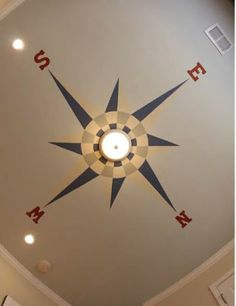 Travel-Themed Nursery Compass Ceiling Medallion but with blue ceiling and globe light shade