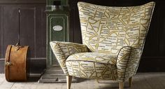 An eclectic range of wallpaper ranging from city scapes, maps & tea cups. Wingback Chair, Armchair, Contemporary Upholstery Fabric, Linwood Fabrics, Sofa Design, Interior Design, Furniture Upholstery, Upholstery Fabrics, White Beams