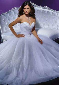 Bling, deep v-neck, corset top, tooled base wedding dress