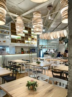 """Intriguing """"spaghetti lamps,"""" created by designer Andrey Galushka from oak veneer, descend from the high concrete ceiling for an original and playful touch. Pub Design, Design Blog, Design Studio, Food Design, Retail Design, Store Design, Bar Interior, Restaurant Interior Design, Restaurant Concept"""