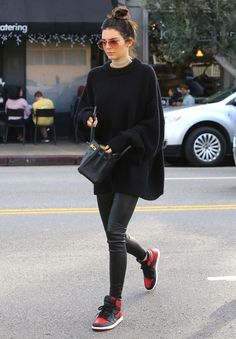 What to Wear With Leggings - Kendall Jenner in an oversize sweater, leather pants and sneakers