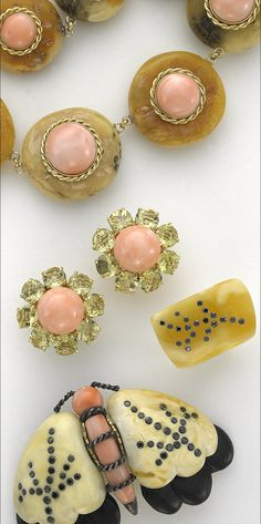 Sorab & Roshi butterscotch amber and pink coral Donut necklace in gold, Daisy flower earrings with lemon citrine & pink coral, butterscotch amber ring with black diamonds and butterscotch amber Moth pin with ebony wood, pink coral and black diamonds.