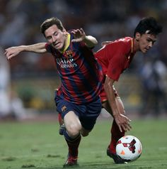 Lionel Messi #10 of Barcelona is brought down inside the box by Atit Daosawang #5 of Thailand XI during the international friendly match between Thailand XI and FC Barcelona at Rajamangala Stadium on August 7, 2013 in Bangkok, Thailand.