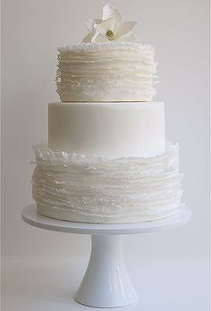 Thin layers of ruffled fondant create these ethereal frills—the effect is light and airy, reminiscent of windblown snow. Cake by Maggie Austin Cak