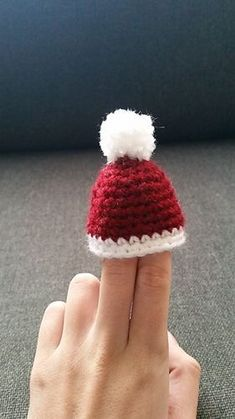 A crochet pattern for small christmas hats. With a chain attached they can be a hanging ornament. They can also be used as egg cosies or just as a cute decoration.Ravelry: Tiny Christmas Hat pattern by Caja vW Crochet Santa Hat, Crochet Tree, Crochet Christmas Decorations, Crochet Christmas Ornaments, Crochet Amigurumi, Christmas Crochet Patterns, Holiday Crochet, Crochet Crafts, Crochet Projects