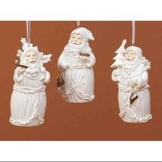 Winter's Beauty White Santa Claus Holding Tree Christmas Ornament