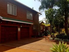 This stunning home is fresh and funky and perfectly located for practical living close to all amenities. Set in a spacious enclosed garden this home. Nook, Property For Sale, Garage Doors, Garden, Outdoor Decor, Plants, Home Decor, Nooks, Garten