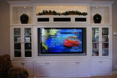 white-wall-unit-built-into-media-niche-with-big-screen-tv