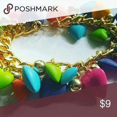 Chunky Rainbow Hearts Charm Bracelet Golden chainlink with lobster clasp closure with vibrant colored heart charms that dangle from it. Jewelry Bracelets