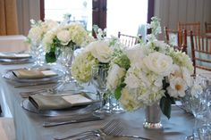 Traditional white arrangements in silver cups