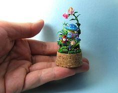 Check out this item in my Etsy shop https://www.etsy.com/listing/217154338/micro-clay-diorama-micro-garden-mushroom