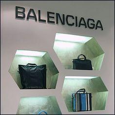 Only you can decide if this Balenciaga Purse Hexagonal Wall Niche Display carries the theme so far as to be called a honeycomb. Purse Display, Balenciaga Purse, Visual Merchandising, Master Bath, Colour, Purses, Wall, Display Case, Coin Purse