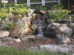 Want to enjoy the sounds and look of a waterfall without a pond? Check out this pondless water feature.