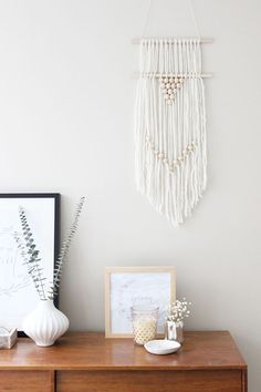 Because it's beautiful, very trendy, affordable and so easy to make!   DIY Boho-Style Wall Hanging by ohthesweetthings.