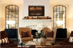 Love the look for the mirrors on either side of the fireplace. Nice alternative to built-ins