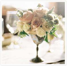 silver urns and pale floral arrangements / photo by Braedon Photography