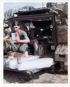 Chunks of ice like these could be purchased for 25.00 in Duc Pho. The soldier relaxing outside of the M113 Armored Personnel Carrier sits on a case of Coca Cola while reading a card. An OG-107 jungle fatigue jacket can also be seen drying outside on the roof of the vehicle.