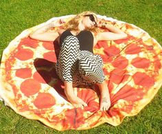 Pizza Towel  Get the perfect tan as you sizzle like a pepperoni under the hot sun while laying out on the pizza towel. This oversized nearly five foot wide pizza comes loaded with melted cheese and greasy pepperoni  making it ideal for the beach or picnics.  $59.95  Check It Out  Awesome Sht You Can Buy